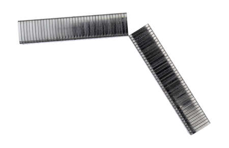 Broken section of industrial steel staples on a white background. Imagens