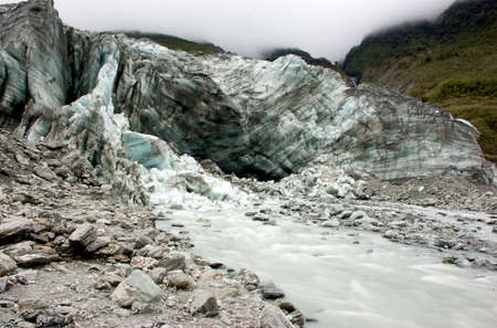 River streaming out of Icy Glacier Stock Photo