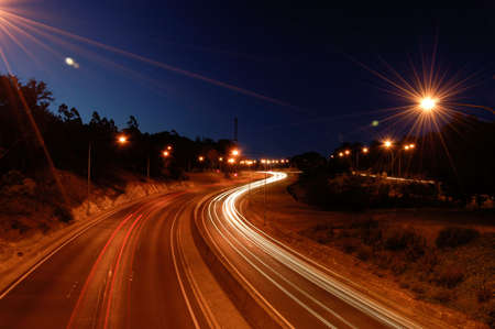 Traffic blur on freeway at night Stock Photo