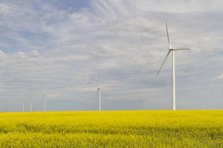 Wind trubine in farmers field Stock fotó