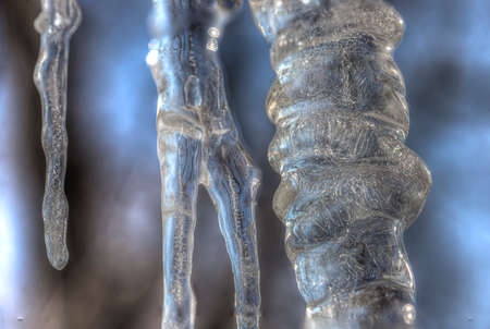 fractures: An icicle display hanging down with detailed crystals and fractures through the fozen interior