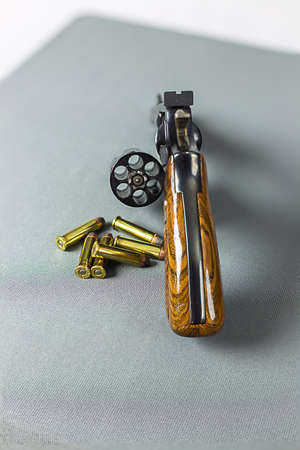 Revolver cylinder open for ammo with bullets ready. photo