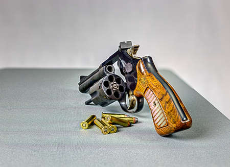 Pistol with open cylinder ready to load to bullets. photo