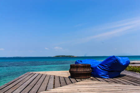 Beautiful wooden pier on beach at Mon-nok island, Rayong, photo