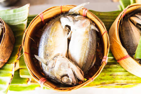 Two Mackerel fish in basket photo
