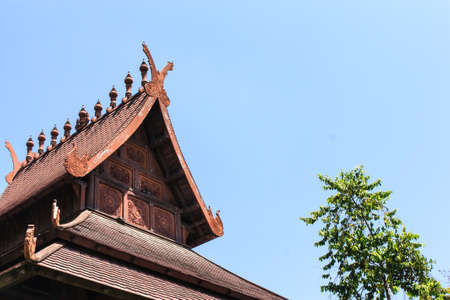 Traditional Thai wooden house in blue sky photo