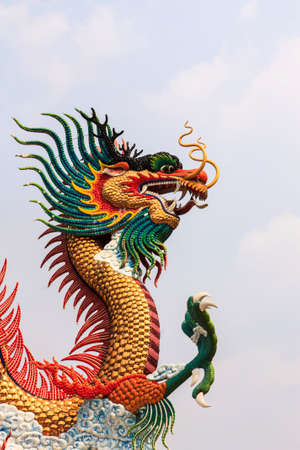 festival scales: golden dragon statue with the blue sky in Nakornsawan province, Thailand