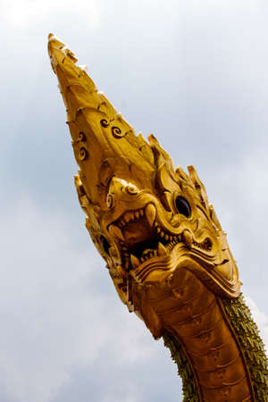 head of naga or water spirit  with blue sky  photo