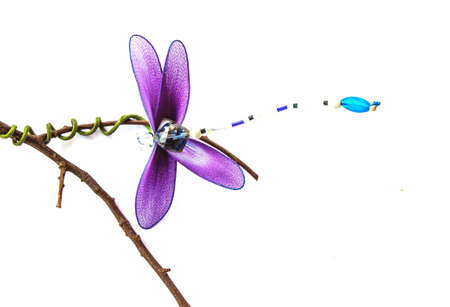snaketail: Close up handmade dragonfly with white background