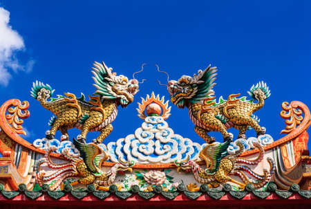 Statue on top of chinese temple,with the body of a horse and the head of a dragon photo