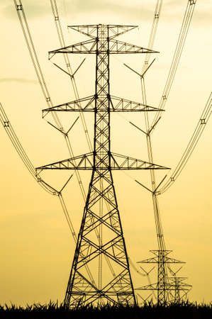eventide: High voltage tower silhouette industrial zone Stock Photo