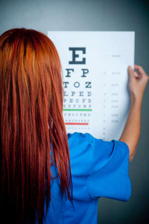 a doctor watching a test for eye examination Stock Photo
