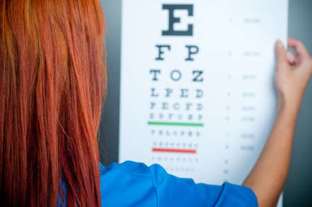 a doctor watching a test for eye examination Stock Photo - 17361601