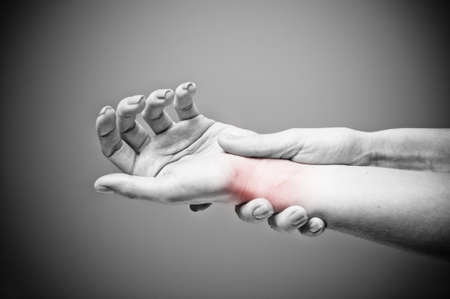 Acute pain in a women wrist Stock Photo - 17346482