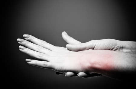Acute pain in a women wrist Stock Photo - 17346479