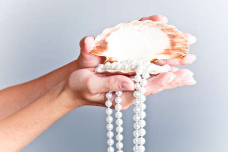 shells and pearls on hand photo