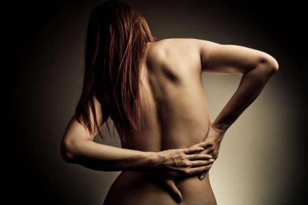 anatomy naked woman: back pain