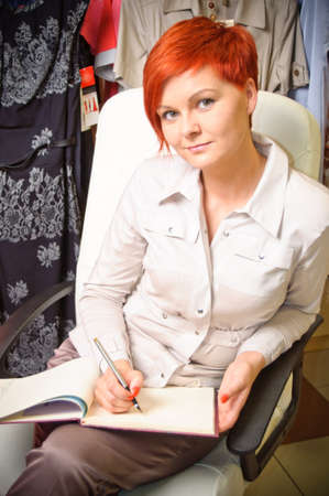 Female sales assistant in clothing store Stock Photo - 17364827