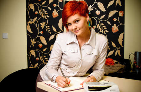 Female sales assistant in clothing store Stock Photo - 17364810