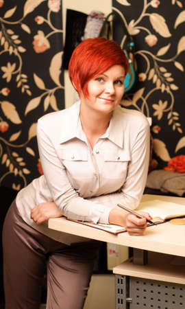 Female sales assistant in clothing store Stock Photo - 17364795