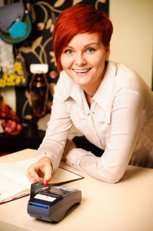 Female sales assistant in clothing store Stock Photo - 17364799