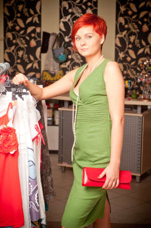 Female sales assistant in clothing store Stock Photo - 17364829