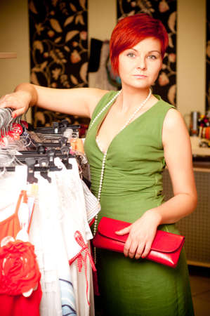 Female sales assistant in clothing store Stock Photo - 17364817