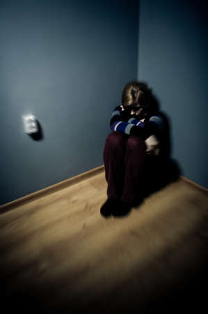 sad woman sitting alone in a empty room Stock Photo - 17802965