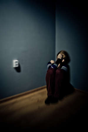 sad woman sitting alone in a empty room Stock Photo - 17802958