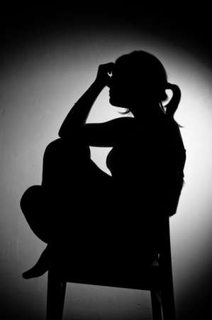sad woman sitting alone in a empty room - black and white Stock Photo - 17802971