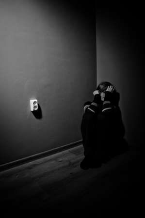 sad woman sitting alone in a empty room - black and white Stock Photo - 17802983