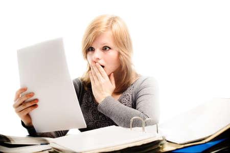 Stressed student revising for an exam - isolated on white backgrground Reklamní fotografie