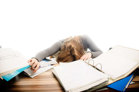 revising: Stressed student revising for an exam - isolated on white backgrground Stock Photo