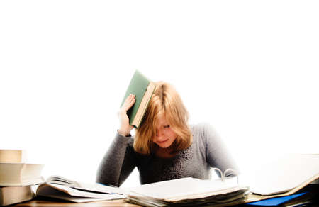 Stressed student revising for an exam - isolated on white backgrground Stock Photo - 17802966