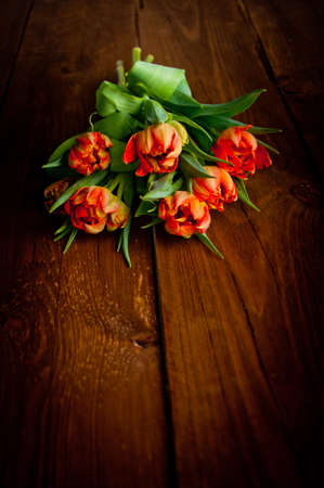 Tulips on rustic wooden table photo