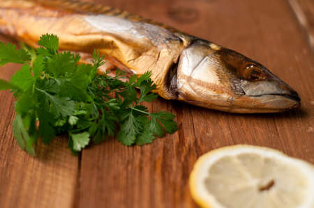 smoked fish (mackerel), on board, selective focus Stock Photo