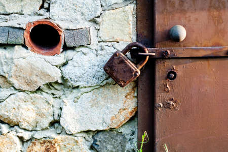 Closeup metal door with lock in grungy style Stock Photo - 20569542