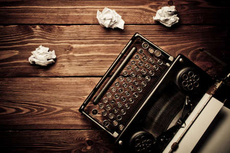Vintage typewriter and a blank sheet of paper, retouching retro photo
