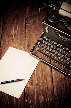 Vintage typewriter and a blank sheet of paper, retouching retro Reklamní fotografie
