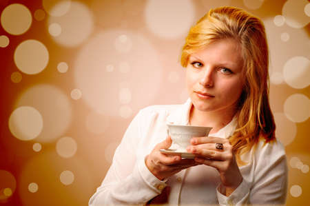 Attractive woman with a cup of coffee Stock Photo