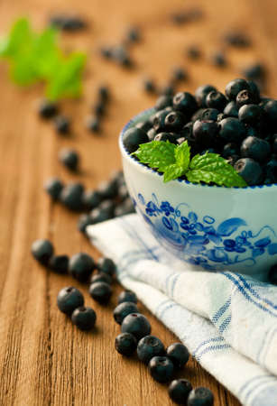 bowl of blueberries on a wooden background Stock Photo