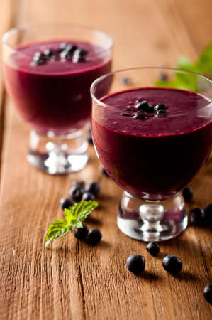 Glass of fresh blueberry smoothie with blueberries Reklamní fotografie