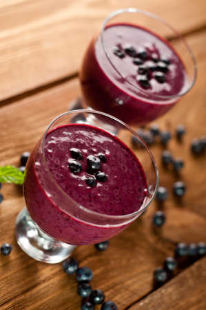 Glass of fresh blueberry smoothie with blueberries Stock Photo