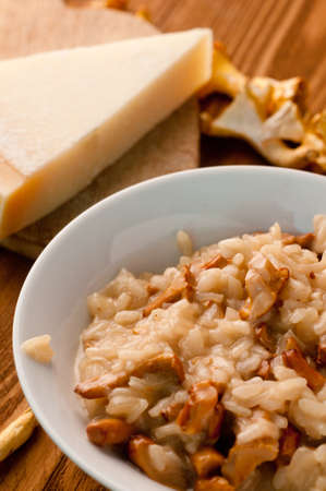 risotto with mushrooms on a wooden background