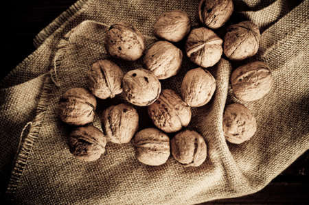 Walnuts on wooden boards. Vintage Retouch. Stock Photo