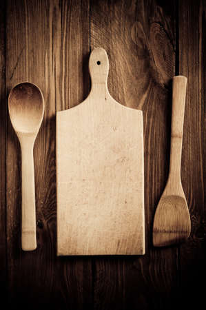 Empty vintage cutting board on planks food background concept photo