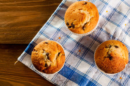 Muffins with almonds on a wooden table Stock Photo