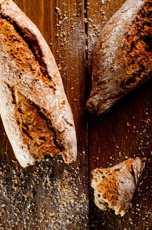 Wholemeal bread on a wooden table photo