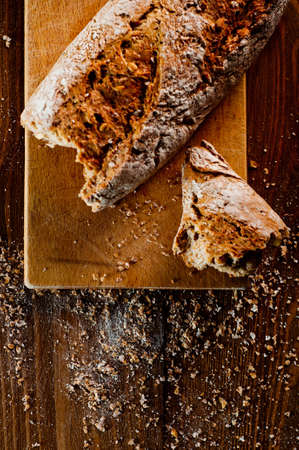 Wholemeal bread on a wooden table Stock Photo