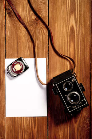 Vintage camera on wooden background photo